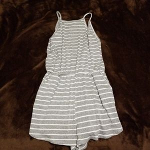 Striped romper with pockets.